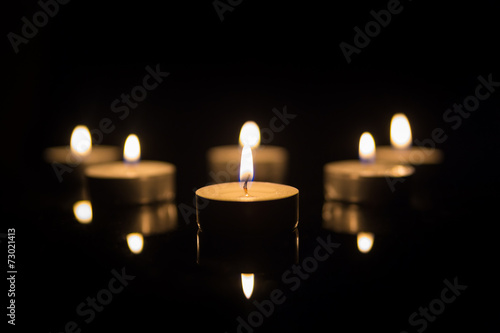 Foto op Canvas Vuur / Vlam Tea Candles with Reflection on Black