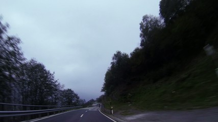 Time lapse shot of car driving on mountian road