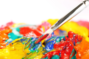 Paint brush with colorful paints, close up