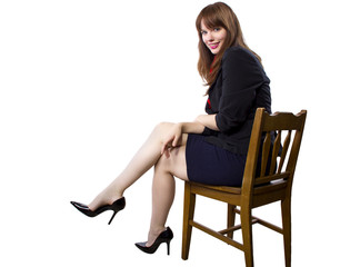 female executive sitting on a chair showing legs and heels
