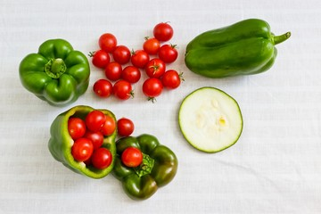 Small tomatoes in cut green pepper with zucchini slice