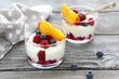 Leinwandbild Motiv yogurt with fresh berries and peaches