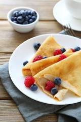 light crepes with fresh berries