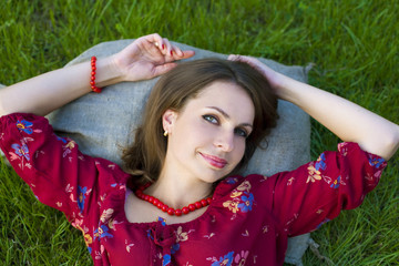 Portrait of beautiful girl lying on the grass