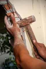 Worker breaking wall