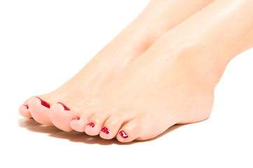 Beautiful female foot with red pedicure