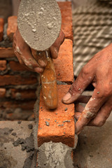 Worker laying brick