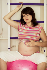 Pregnant woman with gymnastic ball.