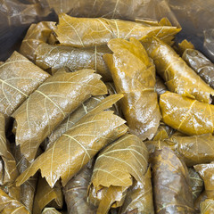 Caucasus dolma from pickled grape leaves and mince