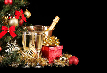 Christmas or New Year's Eve. Champagne and Presents over Black