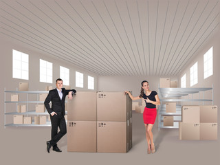 Young woman and man in warehouse