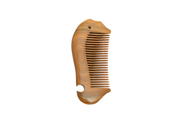 wooden comb on a white background .