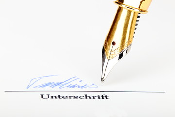 Feder und Unterschrift