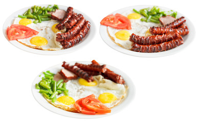 three plates with fried eggs and sausages isolated
