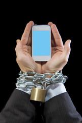 businessman chain locked to mobile phone work addiction