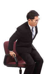 Asian businessman sit on office chair  with back painAsian busin