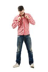 Trendy modern man buttoning shirt