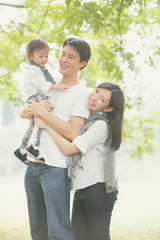 asian family enjoying outdoor park , vintage tone