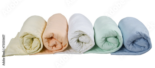 row of colorful twisted blankets isolated on white background - 73030607