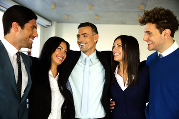 Cheerful businesspeople standing in office