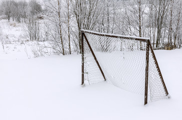 Soccer goal covered with snow
