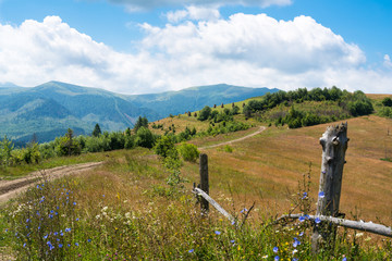 Wooden fence against the landscape in the Ukrainian Carpathians