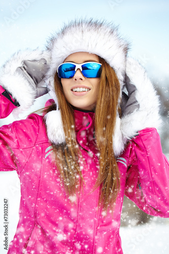 canvas print picture Attractive young woman in wintertime outdoor