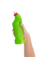 Hand holding green bottle