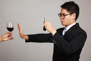Asian businessman drive not drink