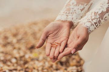 Wedding rings on hands of bride