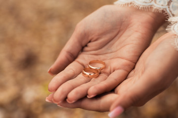 Wedding rings on hands of bride
