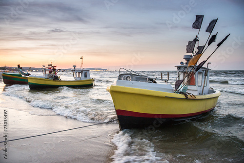 Fishing boats on Baltic Sea beach in Karlikowo, Sopot, Poland - 73035497