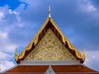 Golden flowers pattern in tympanum of Thai temple.