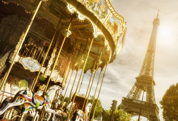 carousel and Eiffel Tower, Paris with sun flare