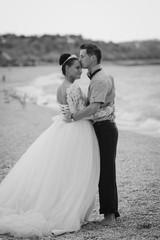 Wedding couple, bride and groom, walking on a beautiful beach