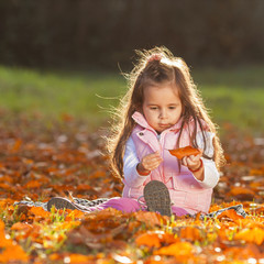 Baby girl on an autumn background