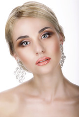 Magnetism. Portrait of Young Blond with Glossy Earrings