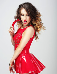 Provocative Female in Red Clothes with Hot Chili Pepper