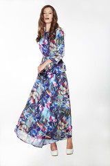 Elegant Fashionable Female in Silky Blue Flowery Dress