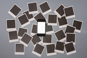 Smartphone with set of real blank instant photo