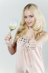 portrait of young woman with a glass of white wine