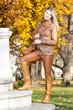 woman standing in autumnal park, Vienna, Austria