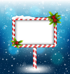 candy cane billboard with holly sprigs in snowfall on blue backg