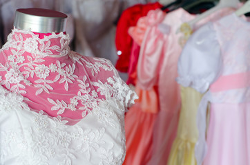 Detail of the beautiful wedding dress in the wedding dress shop