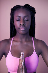 Portrait of black woman meditating