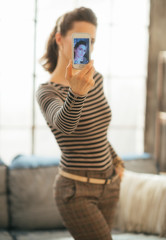 Young woman making selfie in loft apartment