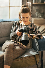 Young woman with dslr photo camera in loft apartment
