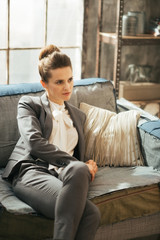Business woman relaxing in loft apartment