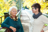 Two women in autumnal park