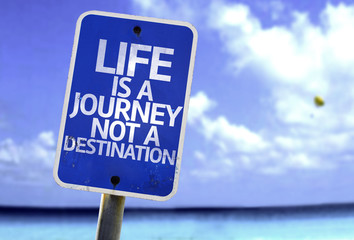 Life is a Journey not a Destination sign with a beach